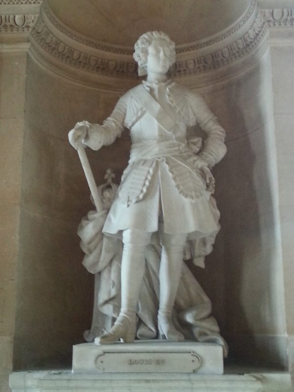 Louis XV in marble on the ground floor of Versailles.