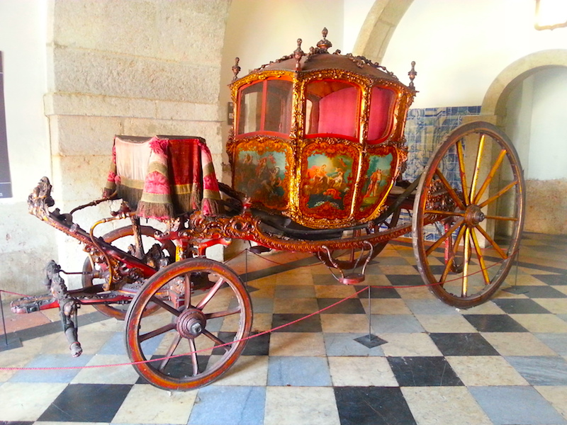A Cinderella-like 18C carriage in the vestibule.