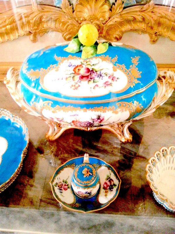Porcelain under glass in the dining room.