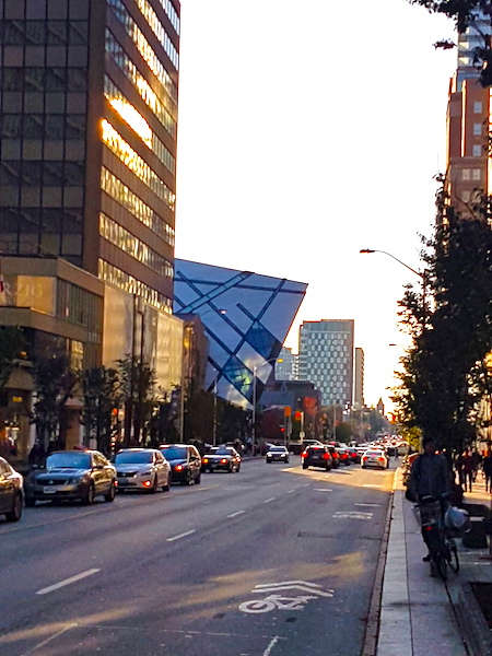 The protuberant glass structure in the middle distance is the main entrance of the Royal Ontario Museum (ROM ) in Toronto.