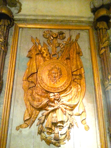 One of the panels of the Cafe Militaire featuring a Medusa head.