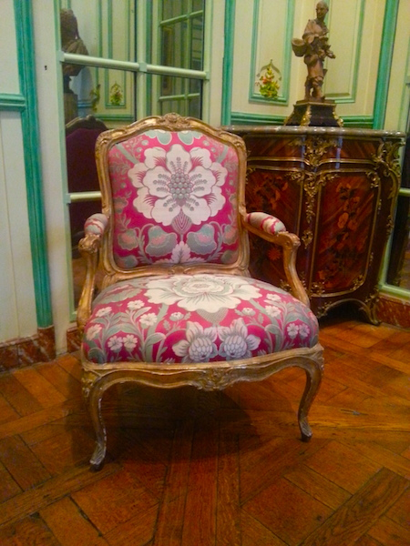 The fauteuil on the right in the 'Green Salon.'