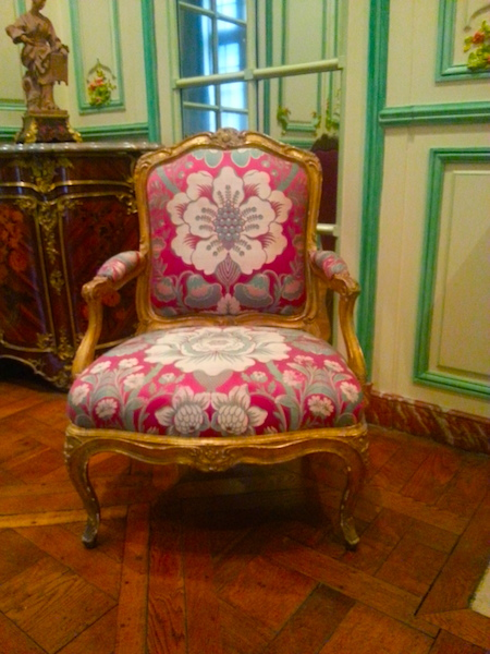 The fauteuil on the left side of the mantel in the 'Green Salon.'
