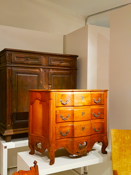 A more rustique commode is visible behind our star in the New France collection at the ROM.