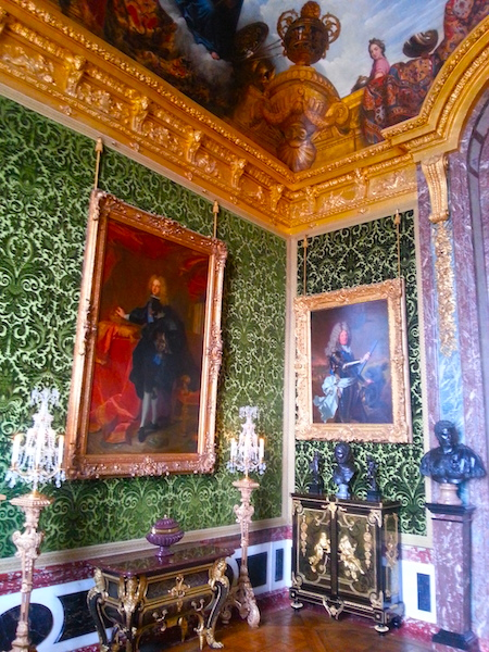 The portrait of Felipe V at left hangs in the room at Versailles which became his state bedroom as king between 16 November and 4 December, 1700.