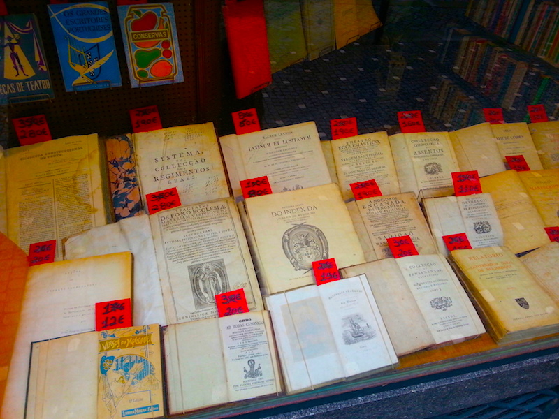 Antiquarian titles in the window of Moreira da Costa.