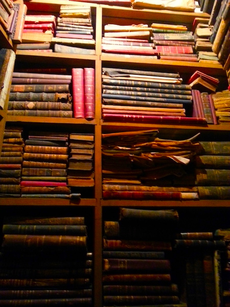 Antique books waiting to be catalogued at.