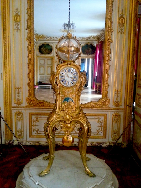 Louis XV's astronomical clock in the Cabinet de la pendule in the Petits Appartements at Versailles.