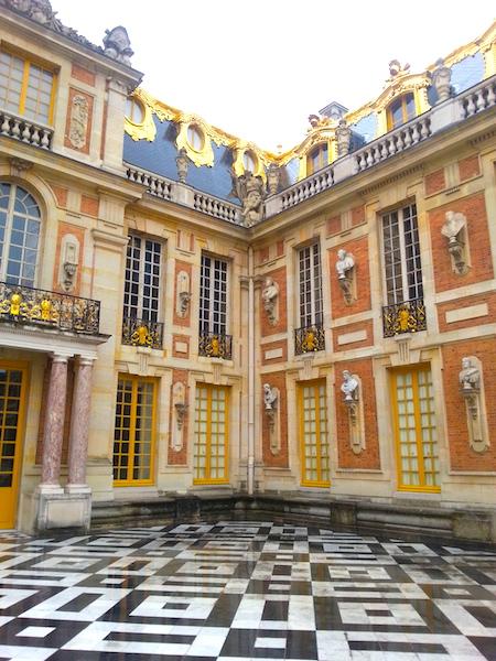 The northern corner of the Cour de Marbre at the Chateau de Versailles.