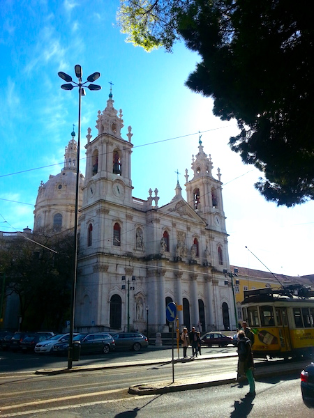 Façade of the Basilica da Estrela in western Lisbon with tram #28 at bottom right.