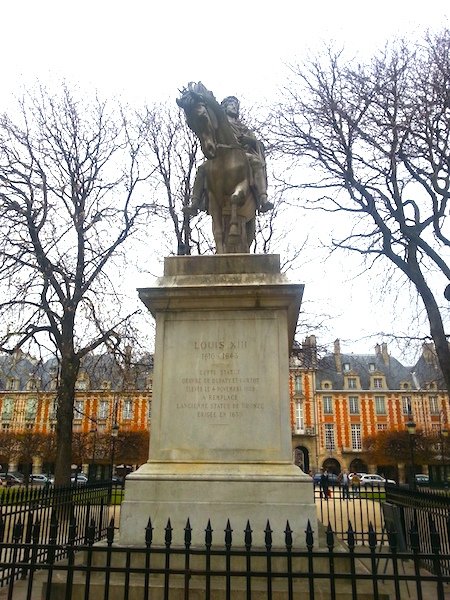Monument to Louis XIII in the Place des Vosges.