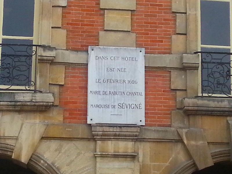 Plaque commemorating the birth of Mme de Sévigné on a house in the Place des Vosges.