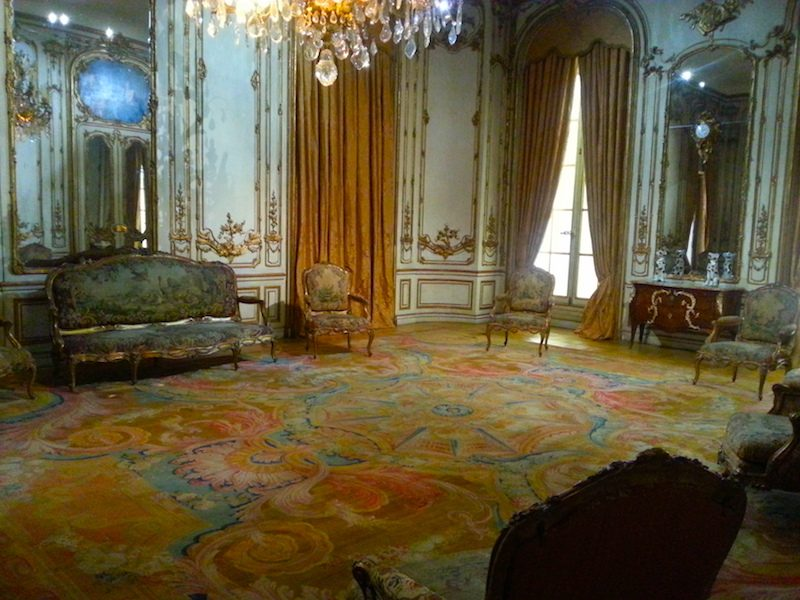 The salon features a large Savonnerie carpet, dated to 1738.